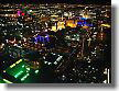 Illuminated night scenes of Las Vegas from a helicopter.